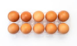 Chicken eggs in plastic package on white. Chicken eggs in plastic package on white background royalty free stock image