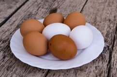 Chicken eggs on a plate Royalty Free Stock Photo