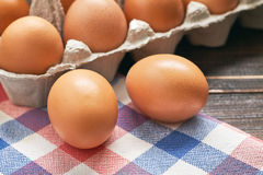 Chicken eggs in pulp egg carton Stock Photo