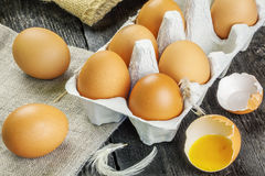 Chicken eggs on rustic wooden table Royalty Free Stock Photo