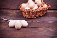 Chicken eggs in shell and in a wicker basket Royalty Free Stock Photo