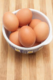 Chicken eggs in a traditional ceramic bowl Stock Photography