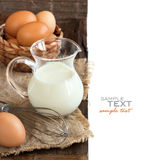 Chicken eggs, whisk and milk Stock Photo