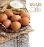 Chicken eggs, whisk,  wheat and flour Royalty Free Stock Photo
