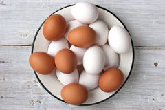 Chicken eggs in the white plate on the white table Royalty Free Stock Image