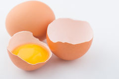 Chicken eggs are on white surface Stock Photography