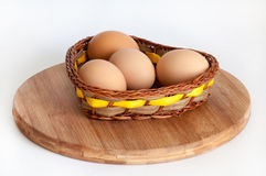Chicken eggs in a wicker basket Stock Photo