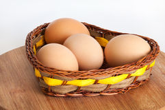 Chicken eggs in a wicker basket Royalty Free Stock Photo