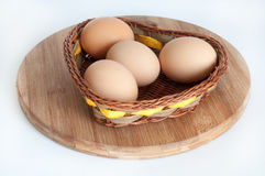 Chicken eggs in a wicker basket Stock Photos