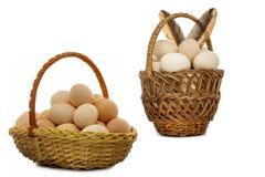 Chicken eggs in a wicker basket Royalty Free Stock Image
