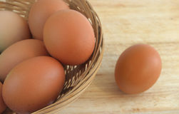 Chicken eggs in a wicker basket Stock Images