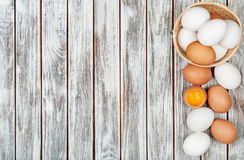 Chicken eggs. On wooden background Stock Photo