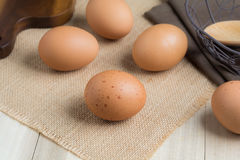 Chicken eggs. On wooden background royalty free stock images