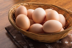 Chicken  eggs on wooden background Royalty Free Stock Image