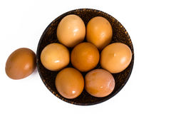 Chicken eggs in wooden bowl on white background Royalty Free Stock Photos