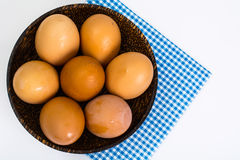 Chicken eggs in wooden bowl on white background Royalty Free Stock Photography