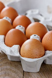 Chicken eggs on a wooden rustic table Royalty Free Stock Photo