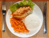 Chicken escalope with steamed rice and carrot salad Stock Images