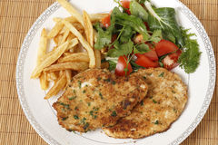 Chicken escalopes meal high angle Royalty Free Stock Photography