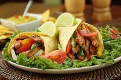 Chicken fajita with guacamole and tortillas royalty free stock photos