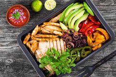 Chicken Fajita Platter with Avocado, Pita Bread, Bell Pepper, Lime, Red Onion and Cilantro, bowl with salsa sauce, clos royalty free stock photo