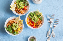 Chicken fajitas bowls on a blue background, top view. Flat lay Stock Images