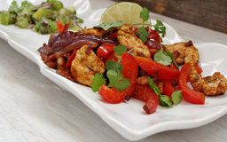 Chicken Fajitas with Lime Salsa. Mexican chicken fajita strips with lime salsa,red pepper and cilantro Stock Images