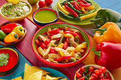 Chicken fajitas mexican guacamole pico gallo chili. Chicken fajitas with mexican food guacamole pico de gallo chili peppers sauce and nachos royalty free stock image