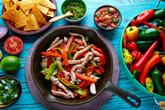 Chicken fajitas in a pan chili and sides Mexican Royalty Free Stock Images