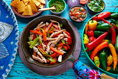 Chicken fajitas in a pan chili and sides Mexican Stock Images