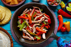 Chicken fajitas in a pan chili and sides Mexican Stock Image