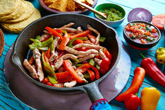 Chicken fajitas in a pan chili and sides Mexican Royalty Free Stock Photo