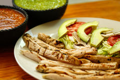 Chicken fajitas with sauces Stock Photography