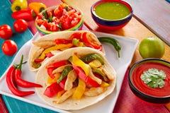 Chicken fajitas tacos mexican food guacamole chili. Chicken fajitas tacos mexican food guacamole pico de gallo chili peppes sauces Stock Image
