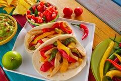 Chicken fajitas tacos mexican food guacamole chili. Chicken fajitas tacos mexican food guacamole pico de gallo chili peppes sauces Royalty Free Stock Photos