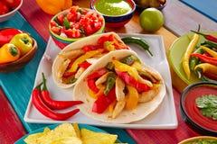 Chicken fajitas tacos mexican food guacamole chili. Chicken fajitas tacos mexican food guacamole pico de gallo chili peppes sauces Stock Images