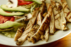 Chicken fajitas on a white plate. Chicken fajitas with vegetables on a white plate Royalty Free Stock Image