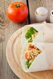 Chicken fajitas on wooden plate Royalty Free Stock Photo