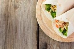 Chicken fajitas on wooden plate top view right corner Stock Image