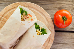 Chicken fajitas on wooden plate top view Royalty Free Stock Image