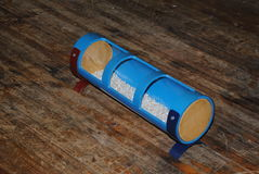Chicken feeding trough made from recycled PVC pipes Stock Photography