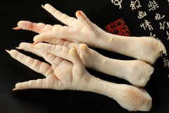 CHICKEN FEET. Fresh raw chicken feet are mostly used for cooking Chinese cuisine Royalty Free Stock Images