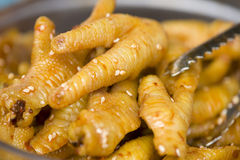 Chicken feet Stock Images