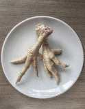 Chicken feet in order to cook Stock Images