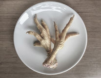 Chicken feet in order to cook Royalty Free Stock Photo