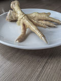 Chicken feet in order to cook Stock Photo