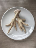 Chicken feet in order to cook Stock Photography