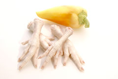 Chicken feet and paprika. Prepared for a soup Stock Image