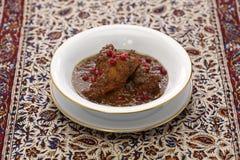 Chicken fesenjan, pomegranate walnut stew, iranian persian cuisine. Khoresht fesenjan ba morgh, chicken stew with pomegranate & walnut, iranian persian cuisine Royalty Free Stock Photography