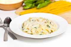 Chicken fettuccine alfredo with spinach Royalty Free Stock Photography